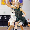 "Holy Family's Claudia Pena keeps the ball from St. Mary's Gabi Florek during the 2011 Tiger Tip-off championship game at Holy Family on Saturday.<br /> More photos please see  <a href=""http://www.broomfieldenterprise.com"">http://www.broomfieldenterprise.com</a><br /> December 8, 2011<br /> Staff photo/ David R. Jennings"