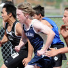 Nederland's Austin Allen and Peak to Peak's Que Tran running in the 100 meter dash during Saturday's Tiger Tornado Invitational trackmeet at Mike G. Gabriel Stadium.<br /> May 05, 2012 <br /> staff photo/ David R. Jennings
