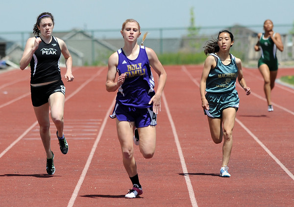 Holy Family's Mckenzie Zeman leads in the 400 meter dash during Saturday's Tiger Tornado Invitational trackmeet at Mike G. Gabriel Stadium.<br /> May 05, 2012 <br /> staff photo/ David R. Jennings