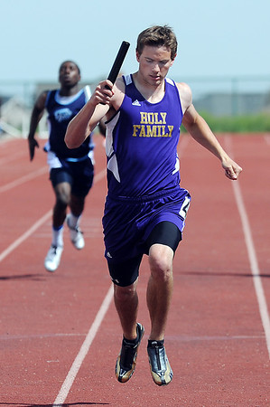 Holy Family's Scout Cox crosses the finish line in the final leg of the 4 X 200 meter relay during Saturday's Tiger Tornado Invitational trackmeet at Mike G. Gabriel Stadium.<br /> May 05, 2012 <br /> staff photo/ David R. Jennings