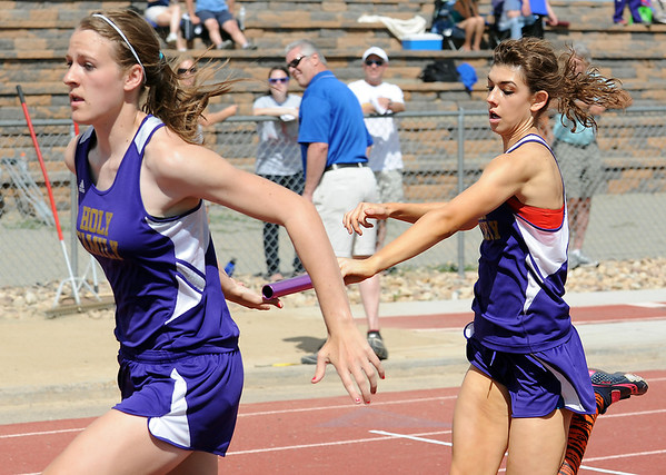 Holy Family's Kassy Johannsen takes the hand off from Monica Stokes running in the 4 X 200 meter relay during Saturday's Tiger Tornado Invitational trackmeet at Mike G. Gabriel Stadium.<br /> May 05, 2012 <br /> staff photo/ David R. Jennings