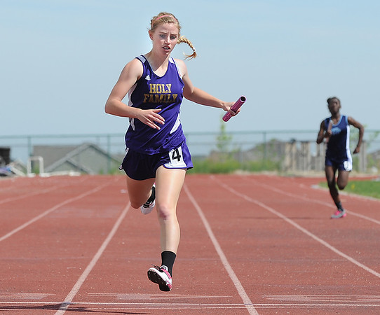 Holy Family's Mckenzie Zeman running final leg of the 4 X 200 meter relay during Saturday's Tiger Tornado Invitational trackmeet at Mike G. Gabriel Stadium.<br /> May 05, 2012 <br /> staff photo/ David R. Jennings