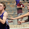 Holy Family's Ryan Willis takes the hand off from Tyler Hsin running in the 4 X 200 meter relay during Saturday's Tiger Tornado Invitational trackmeet at Mike G. Gabriel Stadium.<br /> May 05, 2012 <br /> staff photo/ David R. Jennings