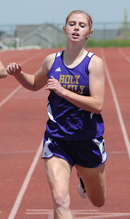 Holy Family's Mckenzie Zeman crosses the finish line in the 400 meter dash during Saturday's Tiger Tornado Invitational trackmeet at Mike G. Gabriel Stadium.<br /> May 05, 2012 <br /> staff photo/ David R. Jennings