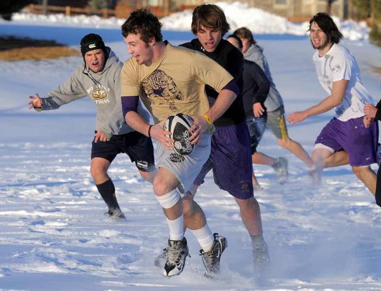 King Medlin runs down the pitch with the ball during Tigers Rugby practice on the Championship Field at the Broomfield County Commons Park on Thursday.<br /> February 9, 2011<br /> staff photo/David R. Jennings