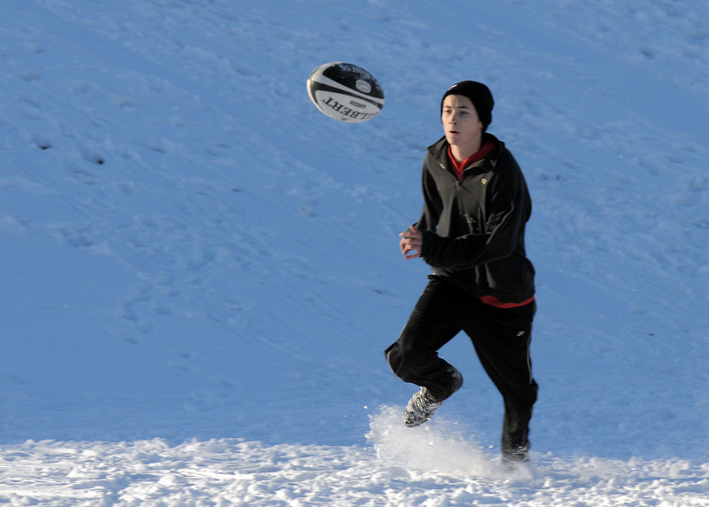 Tyler Hsin goes after the ball during Tigers Rugby practice on the Championship Field at the Broomfield County Commons Park on Thursday.<br /> February 9, 2011<br /> staff photo/David R. Jennings