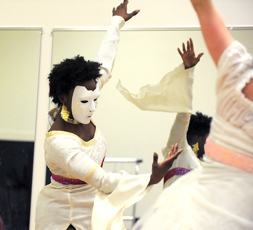 Tobi Compton, left, portrays the dead wife of the preacher during rehearsal for the Ascential Dance Theatre Colorado production of Time of the Preacher (based on Willie Nelsons Red Headed Stranger) at a studio in Lousiville on Friday.<br /> March 16,  2012 <br /> staff photo/ David R. Jennings