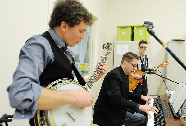 Wilson Harwood, left, banjo, Rainer Franke, keyboard, and Jimmy Curtis, guitar, play during rehearsal for the Ascential Dance Theatre Colorado production of Time of the Preacher (based on Willie Nelsons Red Headed Stranger) at a studio in Lousiville on Friday.<br /> March 16,  2012 <br /> staff photo/ David R. Jennings