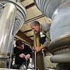 Redstone College student Benjamin Nelson, left, and instructor Steve Hankle discuss what parts maybe needed for restoration of a Titan I rocket engine for display at the Wings Over the Rockies Air and Space Museum in Denver.<br /> February 19, 2013<br /> staff photo/ David R. Jennings