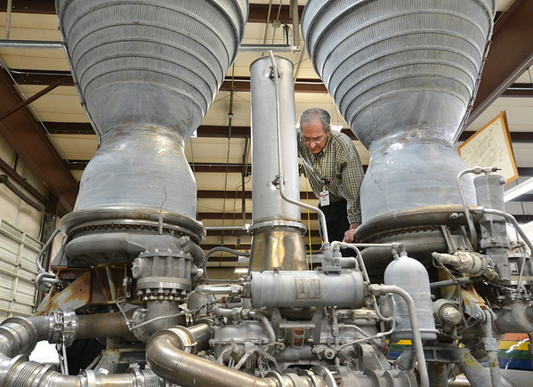 Redstone College instructor  Steve Hankle climbs on a Titan I rocket engine trying to figure out what parts need to be fixed or replaced on Tuesday.  A volunteer group of students and instructors are working on to restore for display at the Wings Over the Rockies Air and Space Museum in Denver.<br /> February 19, 2013<br /> staff photo/ David R. Jennings