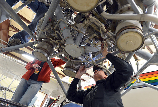 Redstone College student Tanya Orr looks over what is actually the top of a Titan I rocket engine. A volunteer group of students and instructors are working on to restore for display at the Wings Over the Rockies Air and Space Museum in Denver.<br /> February 19, 2013<br /> staff photo/ David R. Jennings