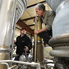 Redstone College student Benjamin Nelson, left, and instructor Steve Hankle discuss what parts maybe needed to help restore a Titan I rocket engine for display at the Wings Over the Rockies Air and Space Museum at the school on Tuesday.<br /> February 19, 2013<br /> staff photo/ David R. Jennings