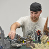 Mike Lewis moves a gaming piece while playing Warhammer 40k  at Total Escape Games on Thursday. The gaming store is holding a ThanksGaming Day fundraiser for Broomfield FISH.<br /> October 25, 2012<br /> staff photo/ David R. Jennings