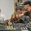 Devin Dewhurst uses a tape measure to determine where his players can move next while playing Warhammer 40k at Total Escape Games on Thursday. The gaming store is holding a ThanksGaming Day fundraiser for Broomfield FISH.<br /> October 25, 2012<br /> staff photo/ David R. Jennings