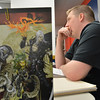 Pathfinder game master Matthew Lambert guides the gamers through the adventure at Total Escape Games on Thursday. The gaming store is holding a ThanksGaming Day fundraiser for Broomfield FISH.<br /> October 25, 2012<br /> staff photo/ David R. Jennings