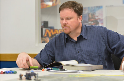 STeve Smith studies what his next move will be while playing Pathfinder, a role playing game, at Total Escape Games on Thursday. The gaming store is holding a ThanksGaming Day fundraiser for Broomfield FISH. October 25, 2012 staff photo/ David R. Jennings