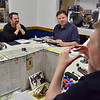 Pathfinder game master Matthew Lambert, right,  guides the gamers through the adventure at Total Escape Games on Thursday. The gaming store is holding a ThanksGaming Day fundraiser for Broomfield FISH.<br /> October 25, 2012<br /> staff photo/ David R. Jennings