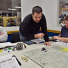 Drew Holder, left, watches as Dino Starinieri prepares to move his character and Steve Smith studies what his next move will be while playing Pathfinder at Total Escape Games on Thursday. The gaming store is holding a ThanksGaming Day fundraiser for Broomfield FISH.<br /> October 25, 2012<br /> staff photo/ David R. Jennings