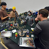 Devin Dewhurst, left, Amanda Bradshaw, Bobby Bradshaw and Mike Lewis play Warhammer 40k  at Total Escape Games on Thursday. The gaming store is holding a ThanksGaming Day fundraiser for Broomfield FISH.<br /> October 25, 2012<br /> staff photo/ David R. Jennings
