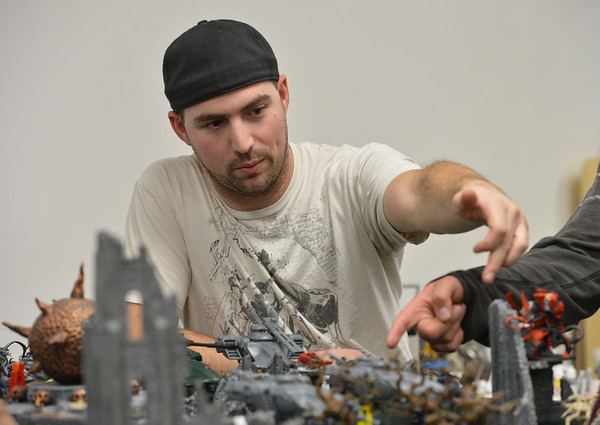 Mike Lewis works out what he will do next while playing Warhammer 40k  at Total Escape Games on Thursday. The gaming store is holding a ThanksGaming Day fundraiser for Broomfield FISH.<br /> October 25, 2012<br /> staff photo/ David R. Jennings