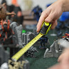 Moves and weapons fire are measured for a game of Warhammer 40k  at Total Escape Games on Thursday. The gaming store is holding a ThanksGaming Day fundraiser for Broomfield FISH.<br /> October 25, 2012<br /> staff photo/ David R. Jennings