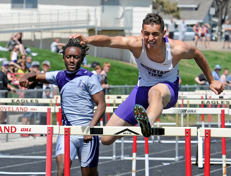 Mountain View's Nolan Kembel runs the boys 100 meter hurdles Thursday, April 14, 2016, during a track meet at Loveland High School. (Photo by Jenny Sparks/Loveland Reporter-Herald)