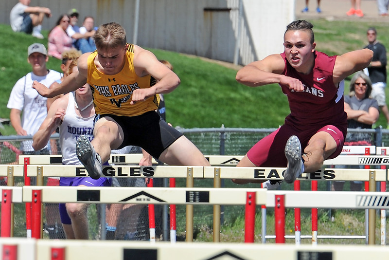 Thompson Valley's Tanner Wall runs the boys 100 meter hurdles Thursday, April 14, 2016, during a track meet at Loveland High School. (Photo by Jenny Sparks/Loveland Reporter-Herald)