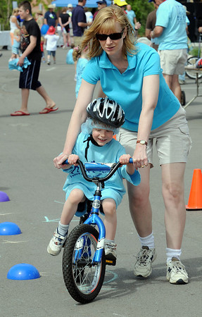 Linda Pulte helps guide her son Andrew 4 1/2 through the bicyle course during the Broomfield Trail Adventure and Children's Wellness day at Anthem Highlands Parkside Community Center on Saturday.<br /> June 5, 2010<br /> Staff photo/ David R. Jennings