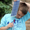 Maxim Tuell, 8, holds a photvoltaic panel during the solar power workshop at Broomfield Trail Adventure and Children's Wellness day at Anthem Highlands Parkside Community Center on Saturday.<br /> June 5, 2010<br /> Staff photo/ David R. Jennings