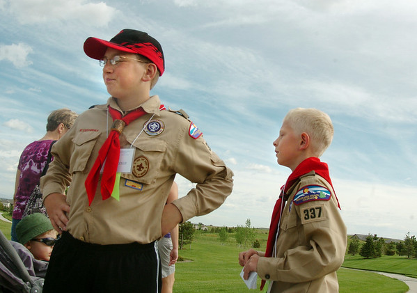 Boys Scouts Alex Townsend, 11, left, and Brendan Wright, 11, inform walkers which fork in the trial to take during the Broomfield Trail Adventure and Children's Wellness day at Anthem Highlands Parkside Community Center on Saturday.<br /> June 5, 2010<br /> Staff photo/ David R. Jennings