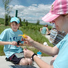 Layla Clark, 11, left, and her mother Lori try to power a fan and a toy car using photovoltaic panels during the solar power workshop at the Broomfield Trail Adventure and Children's Wellness day at Anthem Highlands Parkside Community Center on Saturday.<br /> June 5, 2010<br /> Staff photo/ David R. Jennings