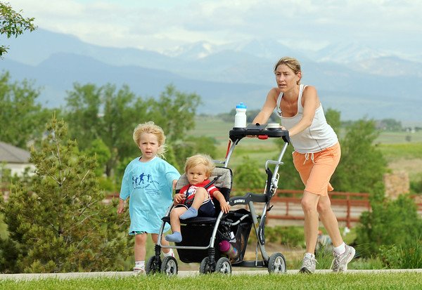Roxane Sondrup, right, with her children Ava, 3, and Rylee, 1, approach the finish line during the Broomfield Trail Adventure and Children's Wellness day at Anthem Highlands Parkside Community Center on Saturday.<br /> June 5, 2010<br /> Staff photo/ David R. Jennings