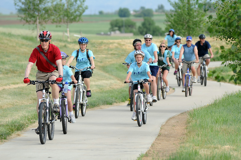 Bicyclists ride a section fo the trail during the Broomfield Trail Adventure and Children's Wellness day at Anthem Highlands Parkside Community Center on Saturday.<br /> June 5, 2010<br /> Staff photo/ David R. Jennings