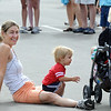 Roxane Sondrup sits with her son Rylee, 1, and daughter Ava, 3, right, after walking the trail during the Broomfield Trail Adventure and Children's Wellness day at Anthem Highlands Parkside Community Center on Saturday.<br /> June 5, 2010<br /> Staff photo/ David R. Jennings