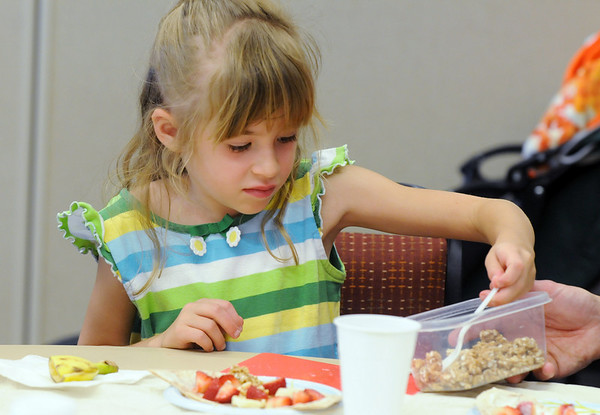 Emma Knight, 6, makes a healthy breakfast at the Bodacious Breakfast workshop during the Broomfield Trail Adventure and Children's Wellness day at Anthem Highlands Parkside Community Center on Saturday.<br /> June 5, 2010<br /> Staff photo/ David R. Jennings