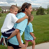 Will Tennyson, 5, is carried by his mother Terry during the Broomfield Trail Adventure and Children's Wellness day at Anthem Highlands Parkside Community Center on Saturday.<br /> June 5, 2010<br /> Staff photo/ David R. Jennings