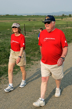Mary Hutchinson and Roland Pillard  hike during the National Trails Day event at the Broomfield Commons on Saturday. Photo by Matt Kelley.
