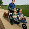 Kate Hansen strolls with her two kids, Scott, 5, and Lucy, 2, during the National Trails Day event at the Broomfield Commons on Saturday. Photo by Matt Kelley.