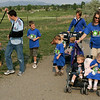 The Carwin and Hansen families hike the trails at the Broomfield Commons during the National Trails Day event on Saturday. Photo by Matt Kelley.