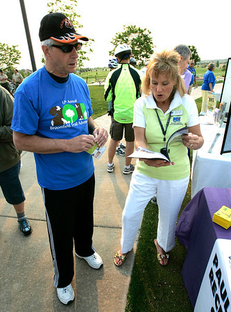 Barb Ploeger, right, gives trail advice to Ray Piccini during theNational Trails Day event at the Broomfield Commons on Saturday. Photo by Matt Kelley.