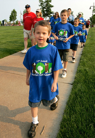 Mason Carwin leads his family out on the the trails at the Broomfield Commons during the National Trails Day event. Photo by Matt Kelley.