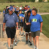 Broomfield Mayor Pat Quinn, left and Open Space Advisor Rob BoDine lead the pack during the National Trails Day event at the Broomfield Commons on Saturday. Photo by Matt Kelley.