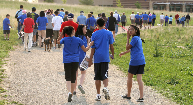 Hikers head toward the Paul Derda Rec Center during the National Trails Day event at the Broomfield Commons on Saturday. Photo by Matt Kelley.