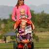 Amanda Winchester, strolls with her daughters Brooklyn, age 2, and Dakota, 4, during the National Trails Day event at the Broomfield Commons on Saturday. Photo by Matt Kelley.