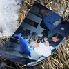 A photograph and toy found by Broomfield Parks employees in  Christmas trees at the tree collection site in Community Park on Thursday. Please contact the Broomfield Enterprise to claim the items.<br /> January 12, 2012<br /> staff photo/ David R. Jennings
