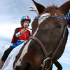 Anna Jager, 10, dressed as Wonder Woman,  trick or treats on horseback around the neighborhood of the Miracles Therapeutic Riding Center for Halloween on Saturday.<br /> October 30, 2010<br /> staff photo/David R. Jennings