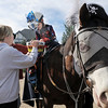 Jack Kleinhelter, 6, takes candy from Patty Bice while trick or treating on horseback around the neighborhood of the Miracles Therapeutic Riding Center for Halloween on Saturday.<br /> October 30, 2010<br /> staff photo/David R. Jennings
