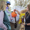 Alexandrea Waugh, 3, dressed as Tinkerbell, with her mother Becky at her side, is given candy Nichole Phelps,as they trick or treat riding Vanna a therapeutic horse around the neighborhood of the Miracles Therapeutic Riding Center for Halloween on Saturday.<br /> October 30, 2010<br /> staff photo/David R. Jennings