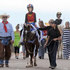 Anna Jager, 10, dressed as Wonder Woman, with help from volunteers trick or treats on horseback around the neighborhood of the Miracles Therapeutic Riding Center for Halloween on Saturday.<br /> October 30, 2010<br /> staff photo/David R. Jennings