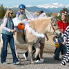 Alexandrea Waugh, 3, dressed as Tinkerbell, with her mother Becky at her side, rides Folley a therapeutic horse lead by Taylor Abfalter, 15, as they trick or treat on horseback around the neighborhood of the Miracles Therapeutic Riding Center for Halloween on Saturday.<br /> October 30, 2010<br /> staff photo/David R. Jennings
